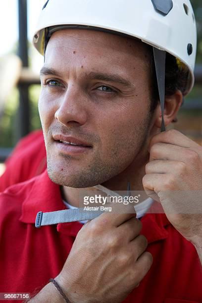 Man doing up safety helmet