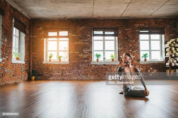 Man doing yoga in studio