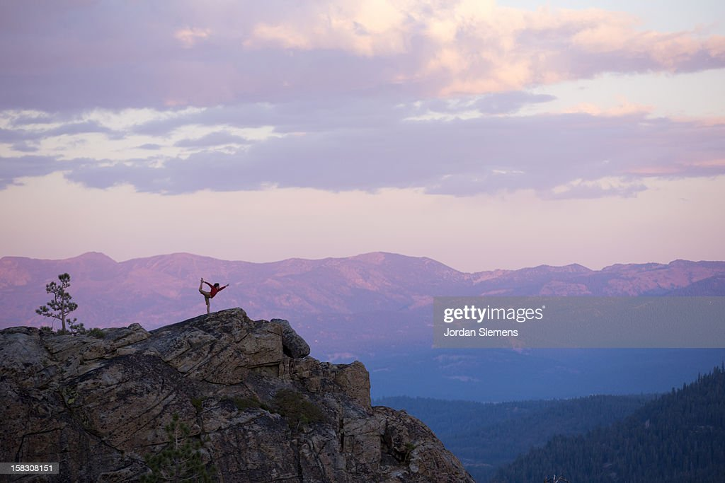 Man doing yoga on a cliff. : Stock Photo