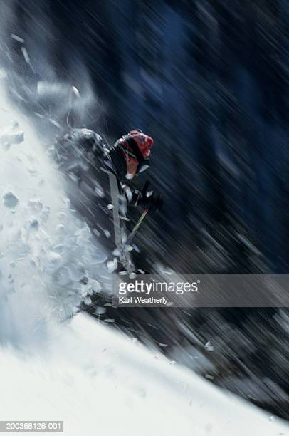 Man downhill skiing, blurred motion