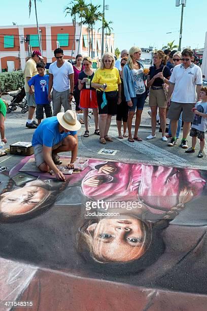 Man drawing a chalk street art portrait