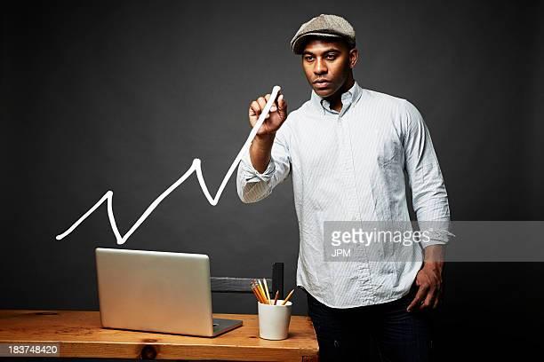 Man drawing line graph