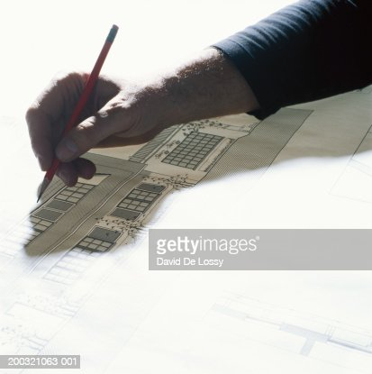 Man drawing with pencil, elevated view
