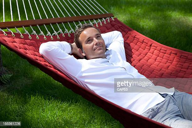 Man Dreaming outside In A Hammock