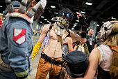 A man dressed as a character from the Borderlands video game waits to enter Awesome Con which celebrates scifi comics and gaming culture at the...