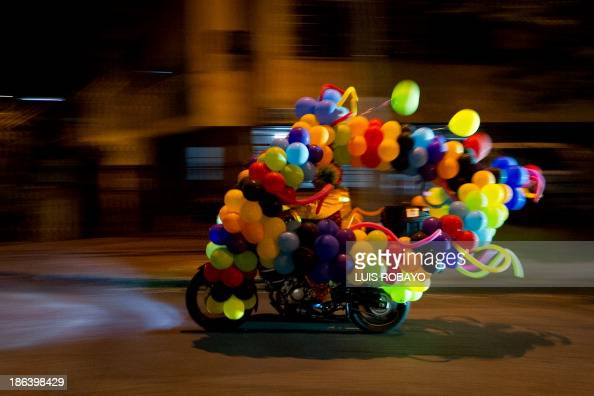 A man dressed as a clown riding his motorcycle during 'MotoHalloween Party 2013' on October 30 in Cali Valle del Cauca department Colombia AFP...