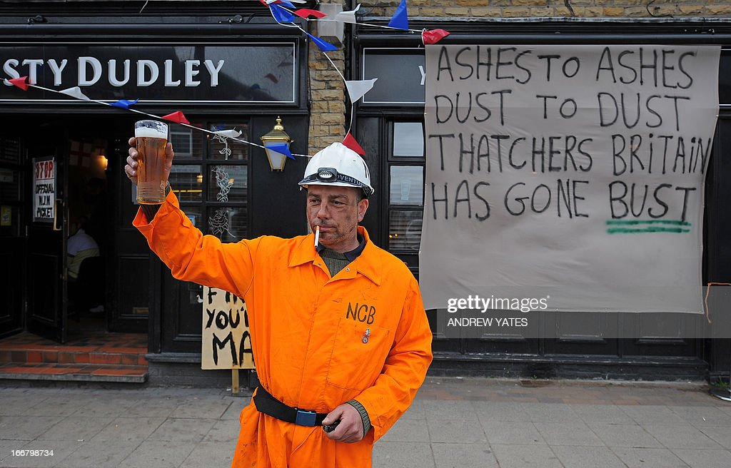 A man dressed as a coal miner holds up a pint of beer during a 'party' to celebrate the death of former British prime minister Margaret Thatcher in Goldthorpe, northen England, on April 17, 2013. The funeral of Margaret Thatcher took place on April 17, with Queen Elizabeth II leading mourners from around the world in bidding farewell to one of Britain's most influential and divisive prime ministers.