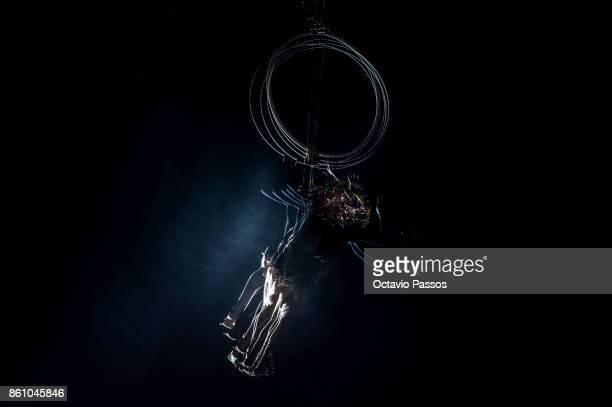 Man dressed as a devil shows his talent of suspended gymnastics on the Witches' Night on October 13 2017 in Montalegre Portugal Witches Night occurs...