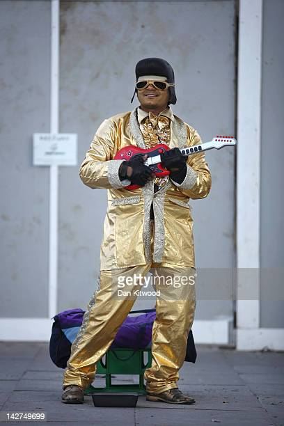 A man dressed as a golden Elvis stands on the South Bank on April 11 2012 in London England The South Bank which runs alongside the River Thames is...