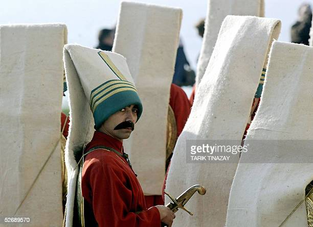 A man dressed as a Janissery Ottoman Empire soldier is seen during the commomeration ceremony of the Gallipoli battle 24 April 2005 in Gallipoli The...