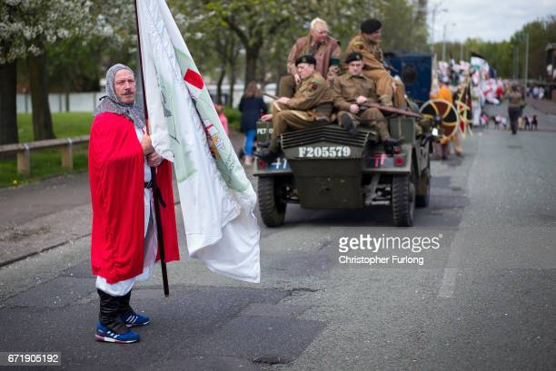 A man dressed as a knight and reenactors take part in the Manchester St George's Day parade through the streets on April 23 2017 in Manchester...