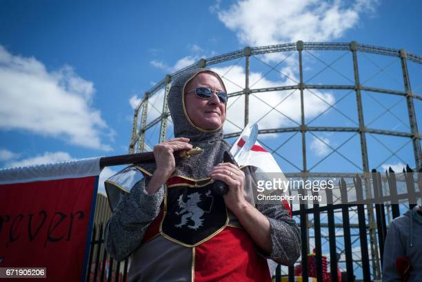 A man dressed as a knight stands by the gasworks as he watches the Manchester St George's Day parade through the streets on April 23 2017 in...