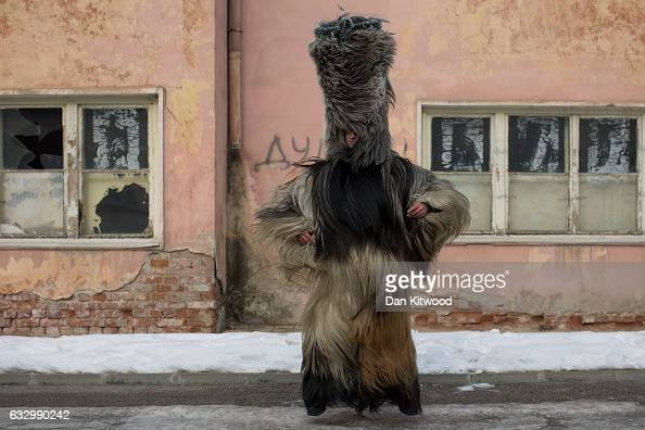 A man dressed as a Kukeri checks the fit on his costume by shaking it around ahead of the start of the second and final day of the annual Surva...