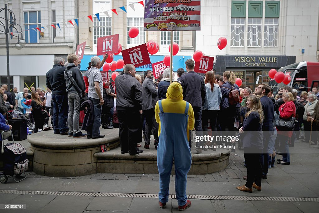 A man dressed as a Minion, advertising a local shop, tries to get some free TV exposure as Labour Leader Jeremy Corbyn and former leader Ed Miliband address supporters and members of the public in Doncaster town centre on May 27, 2016 in Doncaster, England. The Labour In campaign battle bus arrived in Doncaster today with Labour leader Jeremy Corbyn and Ed Miliband MP to canvass for votes and hope to persuade UK citizens to stay in the European Union when they vote in the EU Referendum on the June 23.