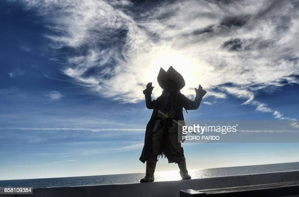 A man dressed as a pirate poses at the Malecon in Puerto Penasco Sonora state Mexico on March 26 2017 / AFP PHOTO / PEDRO PARDO