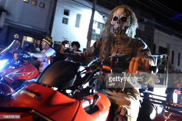 A man dressed as a skeleton driving his motorcycle along the street during the 'MotoHalloween party 2010' on October 28 in Cali Valle del Cauca...