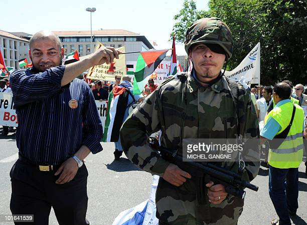 A man dressed as a soldier demonstrate on June 5 2010 in Marseille southern France to protest Israel's storming of a Gazabound aid flotilla that left...