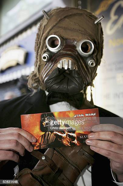 A man dressed as a Star Wars character displays his cinema ticket for the first ever screening of the entire sixfilm Star Wars saga in Leicester...