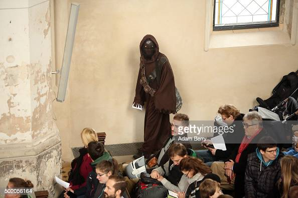 A man dressed as a Star Wars Jawa character arrives for a church service centered around the 1983 film 'Star Wars Episode VI Return of the Jedi' at...