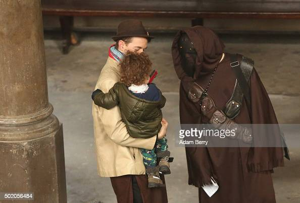 A man dressed as a Star Wars Jawa character speaks to a child as he arrives for a church service centered around the 1983 film 'Star Wars Episode VI...