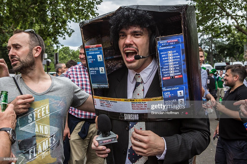 A man dressed as a television sportscaster mingles with the crowd near the Parc des Princes stadium ahead of the football match between Wales and Northern Ireland during UEFA Euro 2016 tournament on June 25, 2016 in Paris, France. The two teams met in the Round of 16 at Parc des Princes in Paris, where Wales won 1-0.