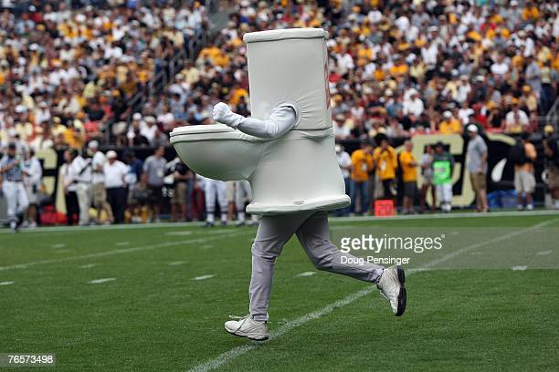 A man dressed as a toilet runs on the field during the Colorado State Rams game against the Colorado Buffaloes at INVESCO Field at Mile High on...