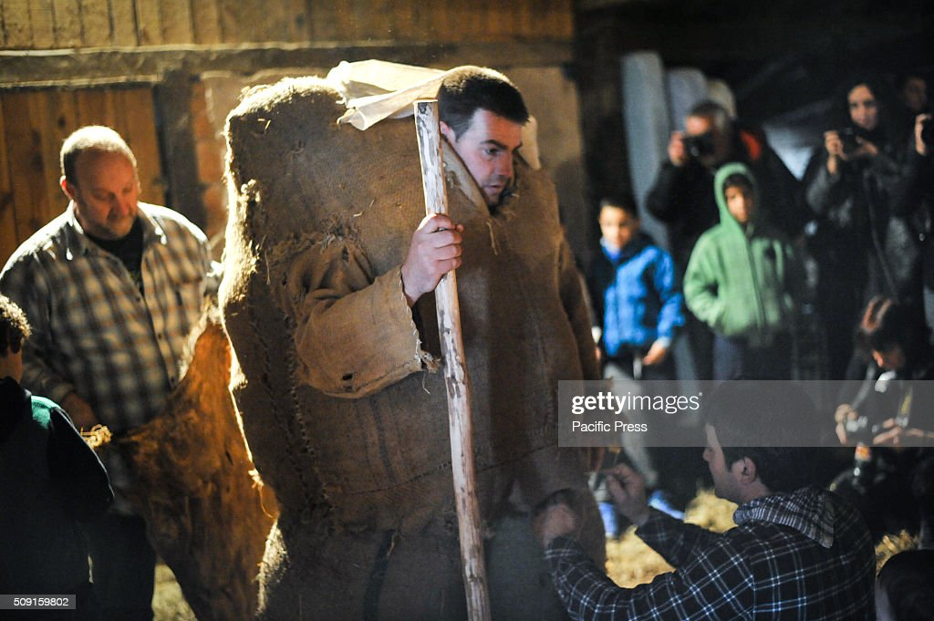 A man dressed as a Ziripot (Costume with straw) prepares to take part in the ancient carnival of Lantz, Navarra.