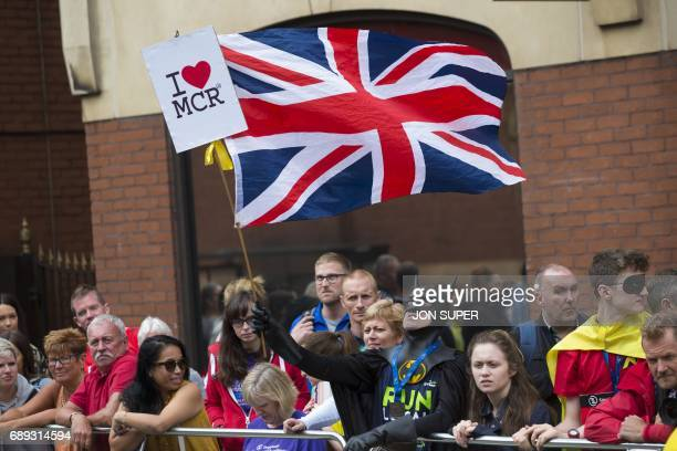 A man dressed as Batman waves a Union flag at the start of the Great Manchester Run in Manchester north west England on May 28 2017 Britain police...