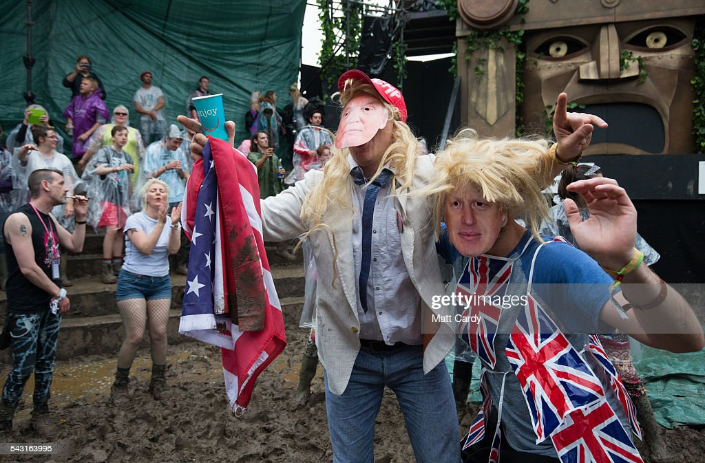 A man dressed as Boris Johnson and Donald Trump prepare to take part in a tomato fight at the Glastonbury Festival 2016 at Worthy Farm, Pilton on June 25, 2016 near Glastonbury, England. The Festival, which Michael Eavis started in 1970 when several hundred hippies paid just £1, now attracts more than 175,000 people.