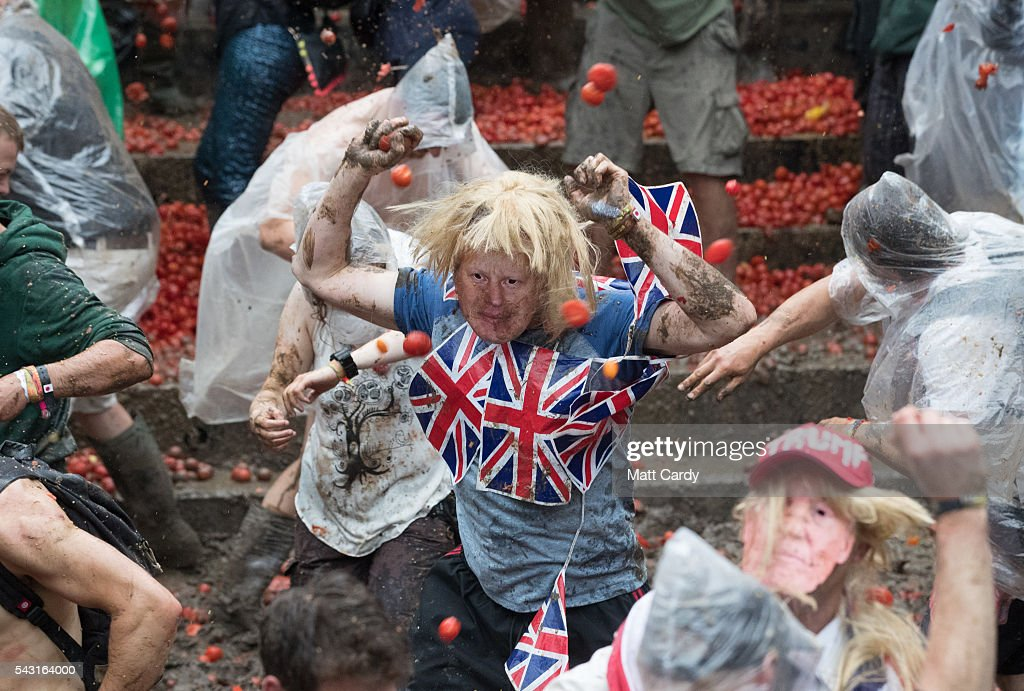A man dressed as Boris Johnson takes part in a tomato fight at the Glastonbury Festival 2016 at Worthy Farm, Pilton on June 25, 2016 near Glastonbury, England. The Festival, which Michael Eavis started in 1970 when several hundred hippies paid just £1, now attracts more than 175,000 people.