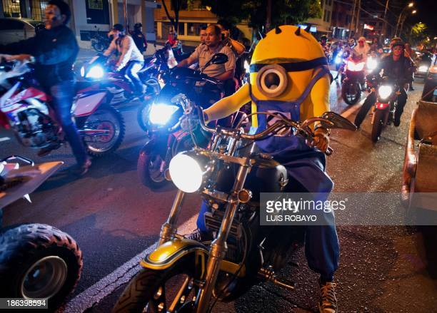 A man dressed as characters from the animated film 'Minions' riding on his motorbike during 'MotoHalloween Party 2013' on October 30 in Cali Valle...