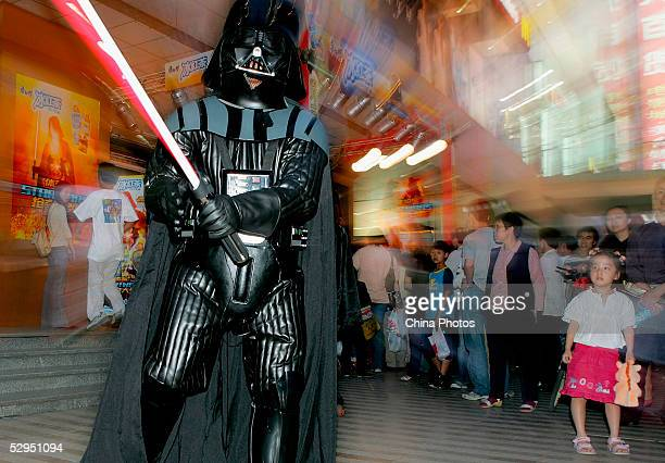 A man dressed as Darth Vaderfrom the movie 'Star Wars Episode III Revenge of the Sith' promotes the film in front of a cinema on May 19 2005 in...