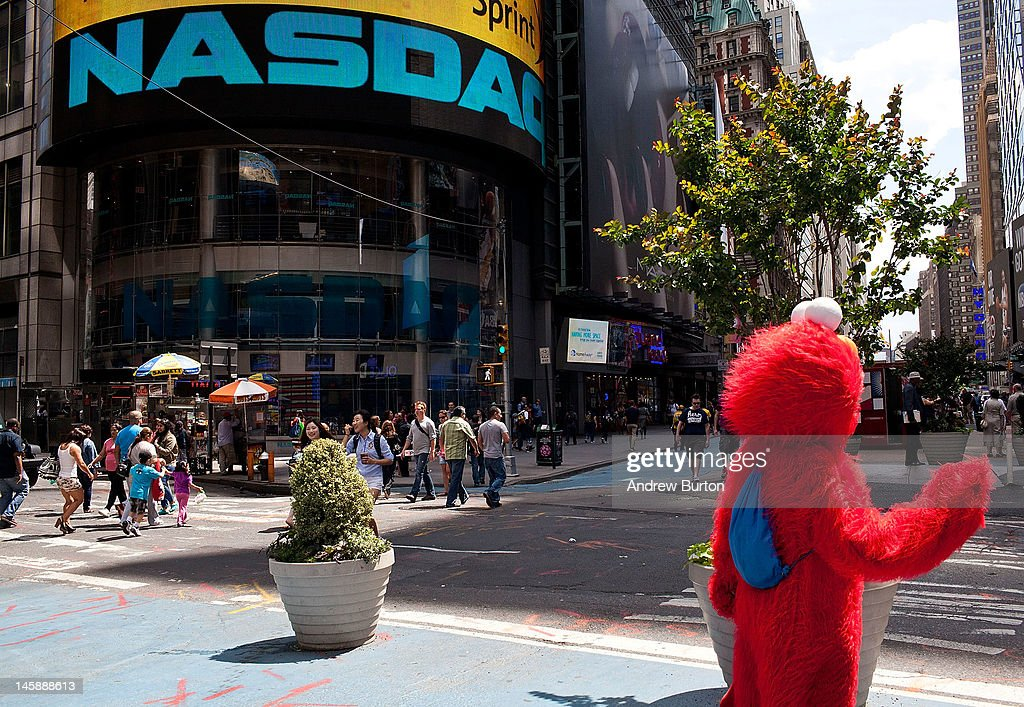 A man dressed as Elmo waves at people outside the Nasdaq exchange in Time Square on June 7, 2012 in New York City. The Nasdaq announced that they plan to set aside $40 million to handle legal proceedings surrounding the recent Facebook IPO.