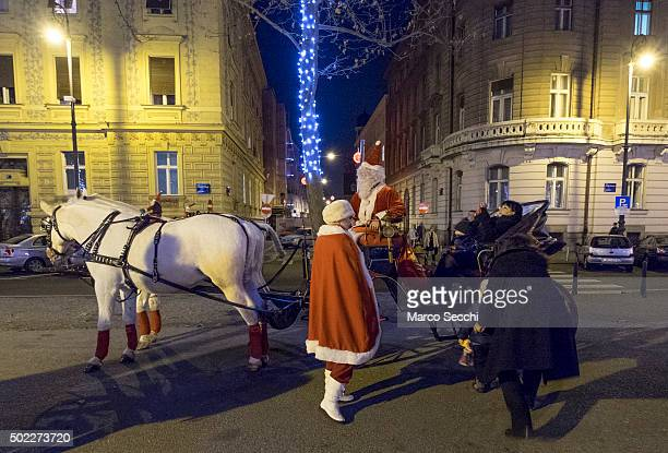 A man dressed as Father Christmas drives a horse carriage at the Advent Market in the city centre on December 22 2015 in Zagreb Croatia Zagreb was...