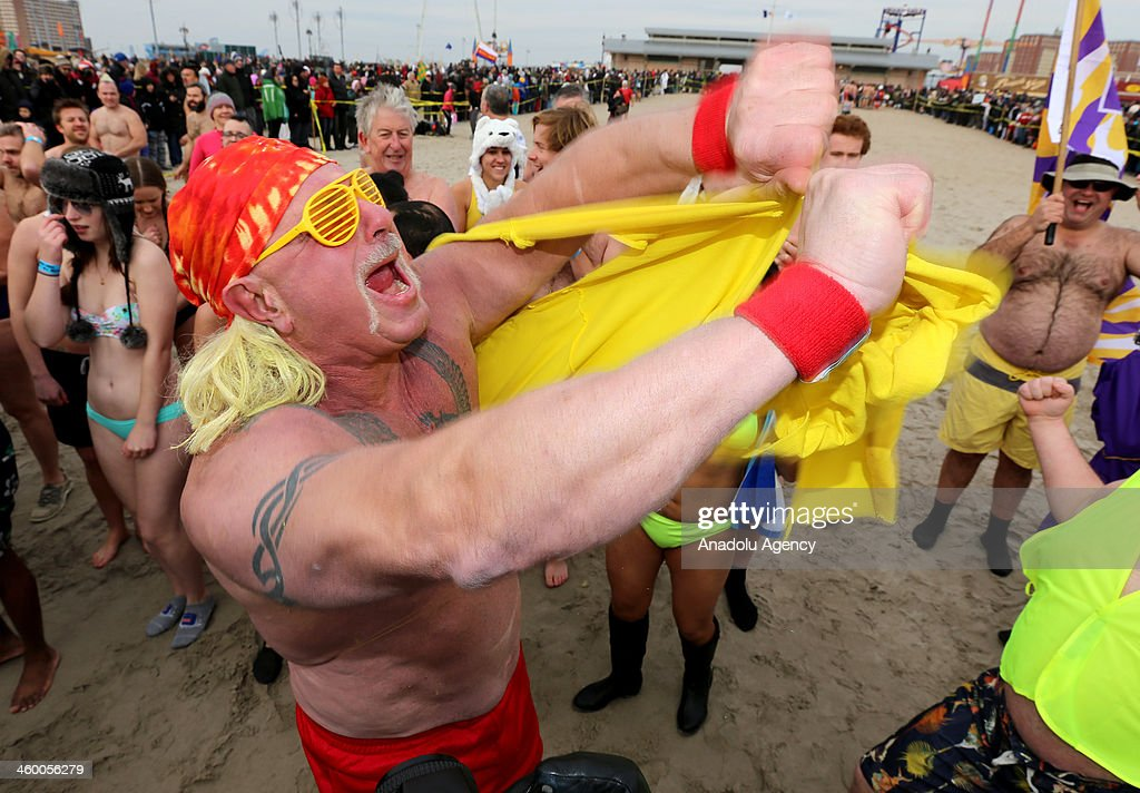 A man dressed as Hulk Hogan amongst some thousands of swimmers taking a dip in the Atlantic Ocean at Coney Island Wednesday as part of the annual Polar Bear Club dip, January 1, 2014.
