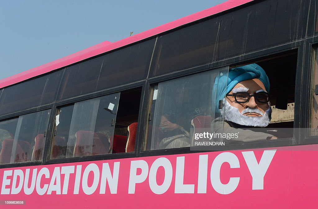 A man dressed as Indian Prime Minister Manmohan Singh sits in the 'Pink Bus' which launched the Campaign for Education as the solution to cure India's rape epidemic at Munirka Bus stand in New Delhi on January 24, 2013. After one month of lurid reporting on a horrifying gang-rape and murder of a student in a bus by five men in New Delhi, women in the Indian capital say they are not safe in Delhi.