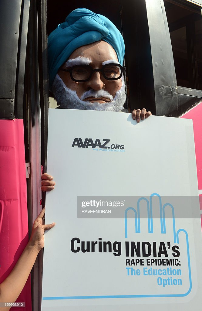 A man dressed as Indian Prime Minister Manmohan Singh stands with a placard on the 'Pink Bus' which launched the Campaign for Education as the solution to cure India's rape epidemic at Munirka Bus stand in New Delhi on January 24, 2013. After one month of lurid reporting on a horrifying gang-rape and murder of a student in a bus by five men in New Delhi, women in the Indian capital say they are not safe in Delhi. AFP PHOTO/RAVEENDRAN