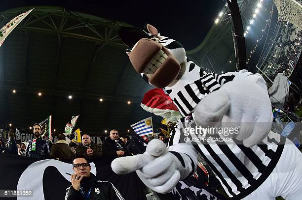 A man dressed as Juventus mascot 'J' entertains supporters ahead of the UEFA Champions League round of 16 first leg football match between Juventus...