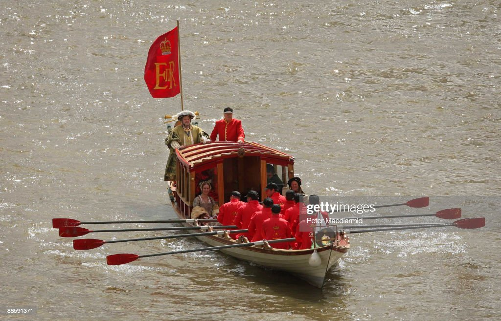 A man dressed as King Henry VIII is rowed along the River Thames in the Royal Shallop 'Jubilant' on June 20, 2009 in London. A weekend of events are being held to mark the 500th anniversary of the coronation of King Henry the VIII in 1509. The Tudor river pageant will end at Hampton Court Palace west of London.