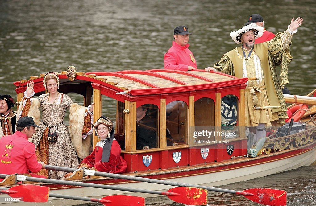 A man dressed as King Henry VIII is rowed along the River Thames in the Royal Shallop Jubilant near Teddington Lock on June 20, 2009 in London . A weekend of events are being held to mark the 500th anniversary of the coronation of King Henry the VIII in 1509. The Tudor river pageant will end at Hampton Court Palace west of London.