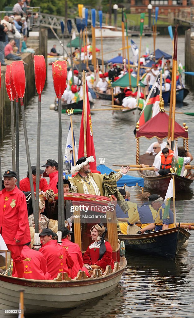 A man dressed as King Henry VIII stands in a flotilla of boats at Teddington Lock on the River Thames on June 20, 2009 in London. A weekend of events are being held to mark the 500th anniversary of the coronation of King Henry the VIII in 1509. The Tudor river pageant will end at Hampton Court Palace west of London.