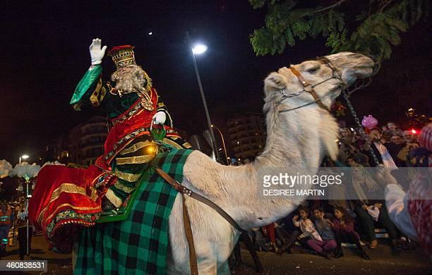 A man dressed as King Melchior one the three wise men or Kings rides a camel during the Three Wise Men Parade in Tenerife on the Spanish Canary...