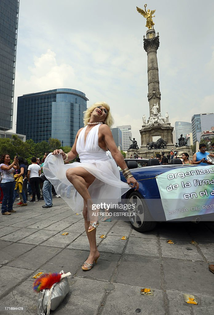 A man dressed as Marilyn Monroe poses during the 35th Gay Pride Parade along Reforma Avenue in Mexico City on June 29, 2013. AFP PHOTO/Alfredo Estrella