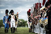A man dressed as Napoleon Bonaparte next to men dressed as Napoelon soldiers take part in a reenactament event on May 31 2015 in Chalon sur Saone AFP...