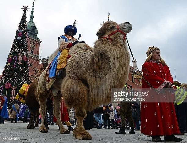 A man dressed as one of the Three Magi sits on a camel during Epiphany celebrations in Warsaw's Old Town on January 6 2014 During Epiphany holiday...