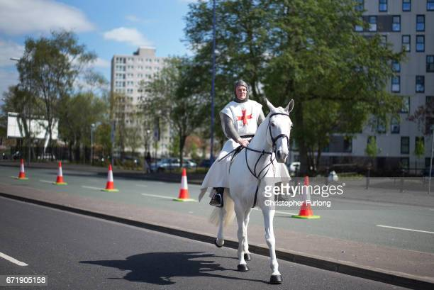 A man dressed as Saint George leads the Manchester St George's Day parade on April 23 2017 in Manchester England Various parades have taken place...