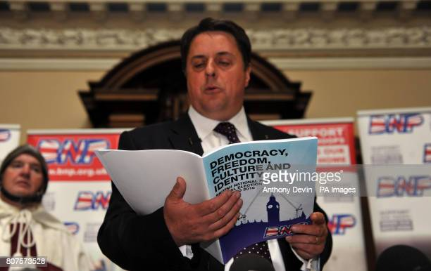 A man dressed as Saint George looks on as Nick Griffin speaks at the Civic Centre in Stoke as the British National Party launch their 2010 General...