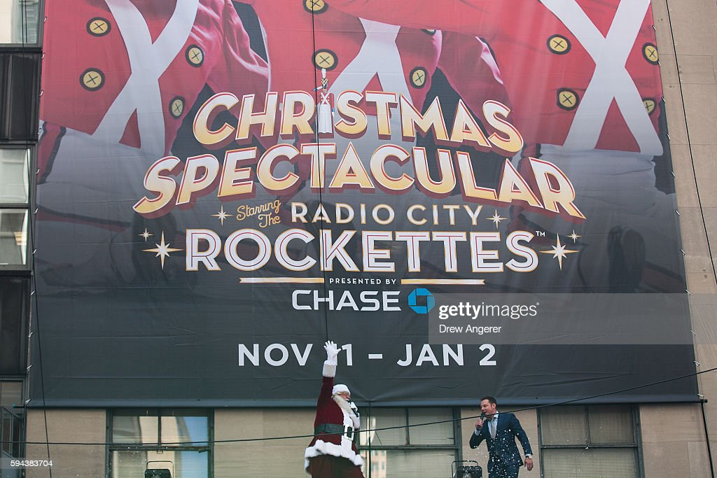 A man dressed as Santa appears above the marquee of Radio City Music Hall at the conclusion of the 'Radio City Rockettes' performance during their...