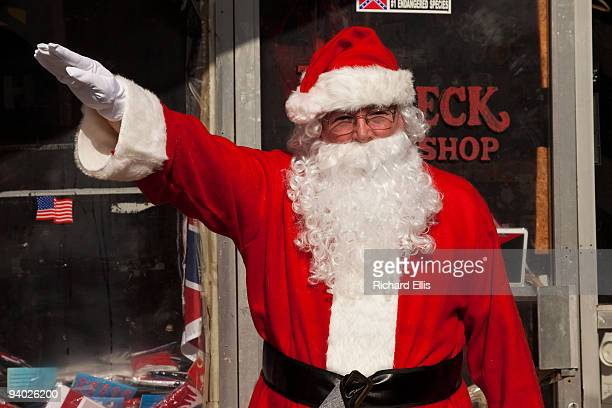 A man dressed as Santa Claus gives a Nazi salute during an event outside the Redneck Shop December 5 2009 in Laurens South Carolina The American Nazi...