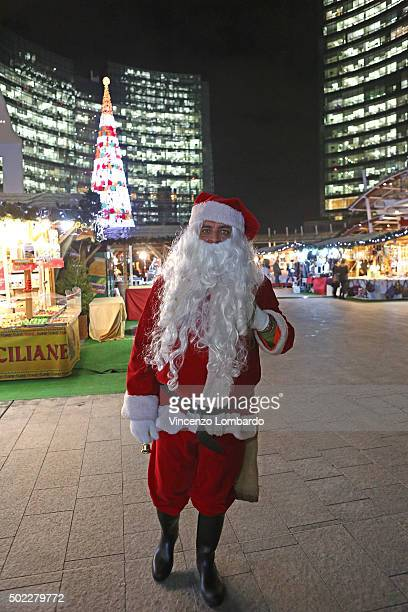 A man dressed as Santa Claus is seen in piazza Gae Aulenti on December 22 2015 in Milan Italy